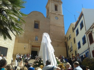 Easter Sunday in the Plaza de Torreta, Finestrat. The statue of Our Lady waits for the Blessed Sacrament to appear in the monstrance at the church door - Parish of San Bartolome